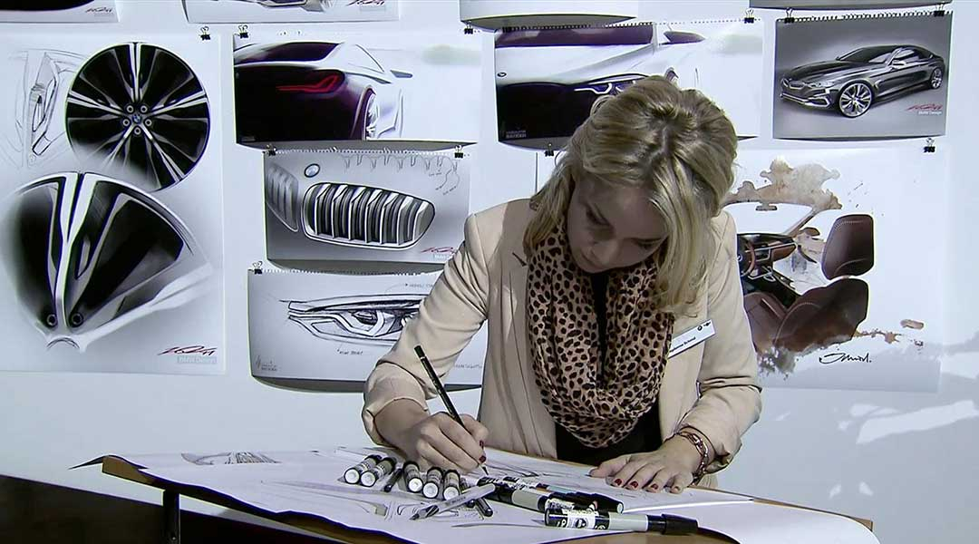 woman drawing a concept car